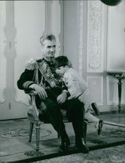 Mohammad Reza Pahlavi seen with his child Reza Pahlavi while Reza is playing with his father