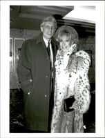 Portrait image of Barbara Eden and her husband taken in an unknown context.