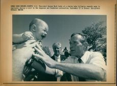 George Walker Bush with crying baby.