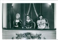 "A photo of actresses Michelle Pfeiffer (left), Geraldine Chaplin (middle) and Winona Ryder (right) from the film ""The Age of Innocence""."