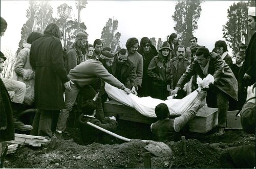 A dead person being buried.