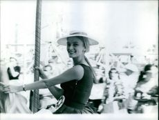 Miss Sweden enjoying carousel horse ride. Miss World contest held in Los Angeles. Photo taken on Aug. 10, 1960.