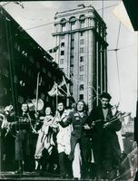 People holding flag and celebrating in the street.