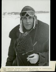 Young Pilot wearing winter suit and smoking.