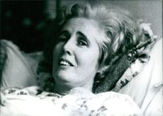Lady Falkender laying on the bed at her home. 1977.