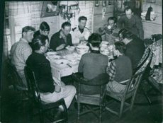 People having their meal while communicating with each other.1940