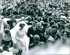 Princess Irene and Carlos Hugo surrounded by people on their wedding day, 1964.