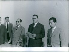 A photo of  Algerian politician Ferhat Abbas while having a press conference.