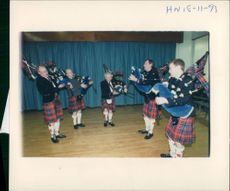 Bagpipe players in full Scottish regalia.