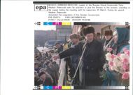 Vladimir Zhirinovsky ask his assistant to give the flowers to the woman.