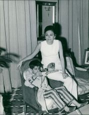 Farah Pahlavi with her son.