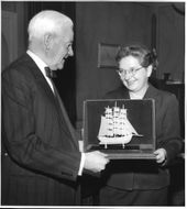 Supreme Court Justice Emil Sandstrom receives gift from the Red Cross