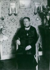 Matilda Hertzberg mother of Brita Hertzberg sitting on a chair, 1937.
