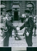 American and Russian Captains handshaking during the Changing of the Guards ceremony in Vienna, Austria.