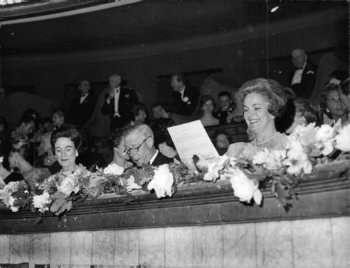 The Duke and Duchess of Windsor in a theater with other guests