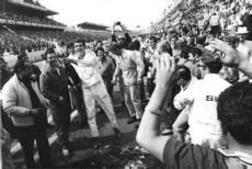Car racers celebrated beside the track after the race.