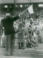 Track and field athlete number 13 won the race during Olympics.  - 1964