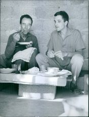 Two men enjoying meal.