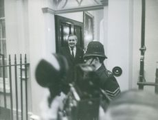 James Callaghan photographed standing by the door.
