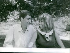 Prince Xavier siting with Madeleine de Bourbon smiling together, 1964.