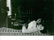 Sacha Distel having free moments with a woman.