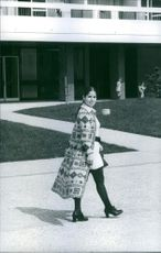 Woman walking and smiling.