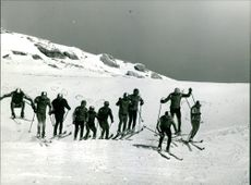 Group of people skiing together.