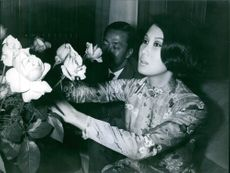 Nguyen Cao Ky siting with his wife, adjusting flowers. 1968