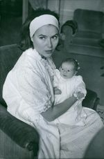 Woman photographed with child.