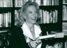 Close up of Princess Michael of Kent, holding a book and smiling