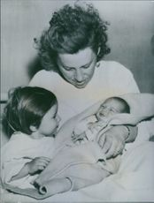 Mrs. Desarka Mohorovici pictured with her daughter Visna (left) and her baby son in the hospital. 1943.