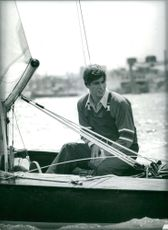 Prince Andrew sitting on boat.
