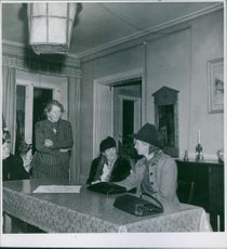 4 ladies having a conversation during wartime. 1940.