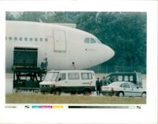 Police stand in front of the french airbus.