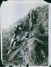 German soldiers concealed behind a haystack during World War 1.