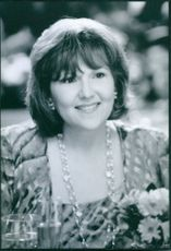 """A photo of Brenda Vaccaro as Doris in the film """"The Mirror Has Two Faces"""". 1996."""