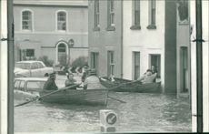 Floods 1966-1989:Stranded households  being rescued.