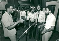 Clive Lloyd with players.
