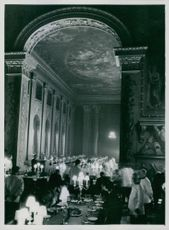 The painted hall, Royal Naval College. Wren Cadets are lunching at the table in the background.  Taken - Circa 1943