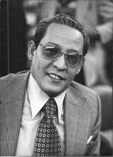 Close up of Indonesian diplomat and former foreign minister Ali Alatas while he looking towards the camera with smiling face