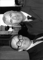 "Jack Smethurst and William Desmond Anthony ""Bill"" Pertwee standing."