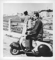 Man riding on a scooter. This photo is from the folder Adolf Eichmann.