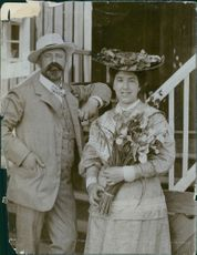 Georg Pauli posing with a woman and smiling.