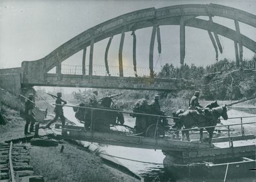 A German M-G company while crossing the Oise Canal. 1940.