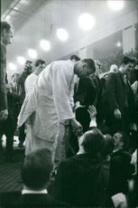 Anton Geesink talking to people. Photo taken Dec 7,1961