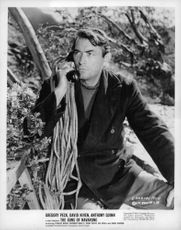 """Gregory Peck on phone in a movie scene of """"The Guns of Navarone"""".  - 1961"""