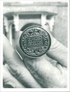 A close-up of the 17th-century seal.