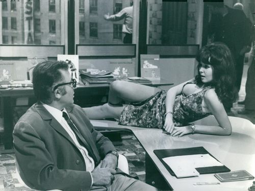 Marie France Boyer lie slanted on a table fronting a man.1967