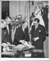 """Sir Robert Hankey studied Queen Elizabeth's coronation bible at the """"Books from Britain 's show in Östermalms Marble Halls."""