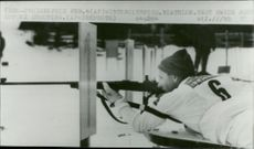The scooter John Guttke is shooting during the Winter Olympics in Innsbruck in 1964